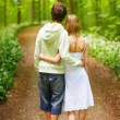 teen-boy-and-girl-walking-in-woods